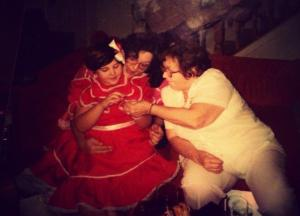 This is my mom, grandma, and myself when I was about 3 or 4. The dress I'm wearing had little bells underneath the skirt and I LOVED to tinkle everywhere where I walked! Wait...